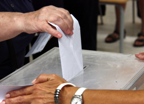 Voter casts her ballot for the 27-S elections