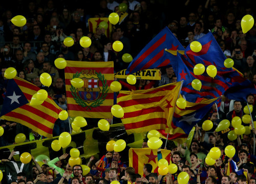 Barça fans throw yellow balloons onto the pitch at Camp Nou (courtesy of Reuters)