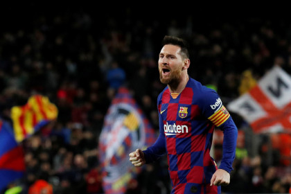 FC Barcelona captain Lionel Messi celebrates scoring one of his three goals in the La Liga match against Celta Vigo (by REUTERS/Albert Gea)