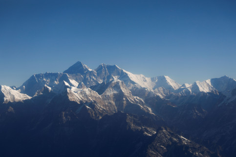 Mount Everest, the world's highest peak, and other peaks of the Himalayan range are seen through an aircraft window during a mountain flight from Kathmandu, January 15, 2020 (by Reuters/Monika Deupala)