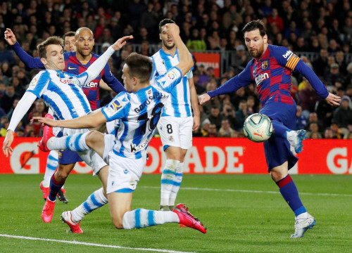 Barcelona's Leo Messi strikes the ball during his side's match with Real Sociedad in the last game Barça played before the Covid-19 pandemic (image by Reuters)