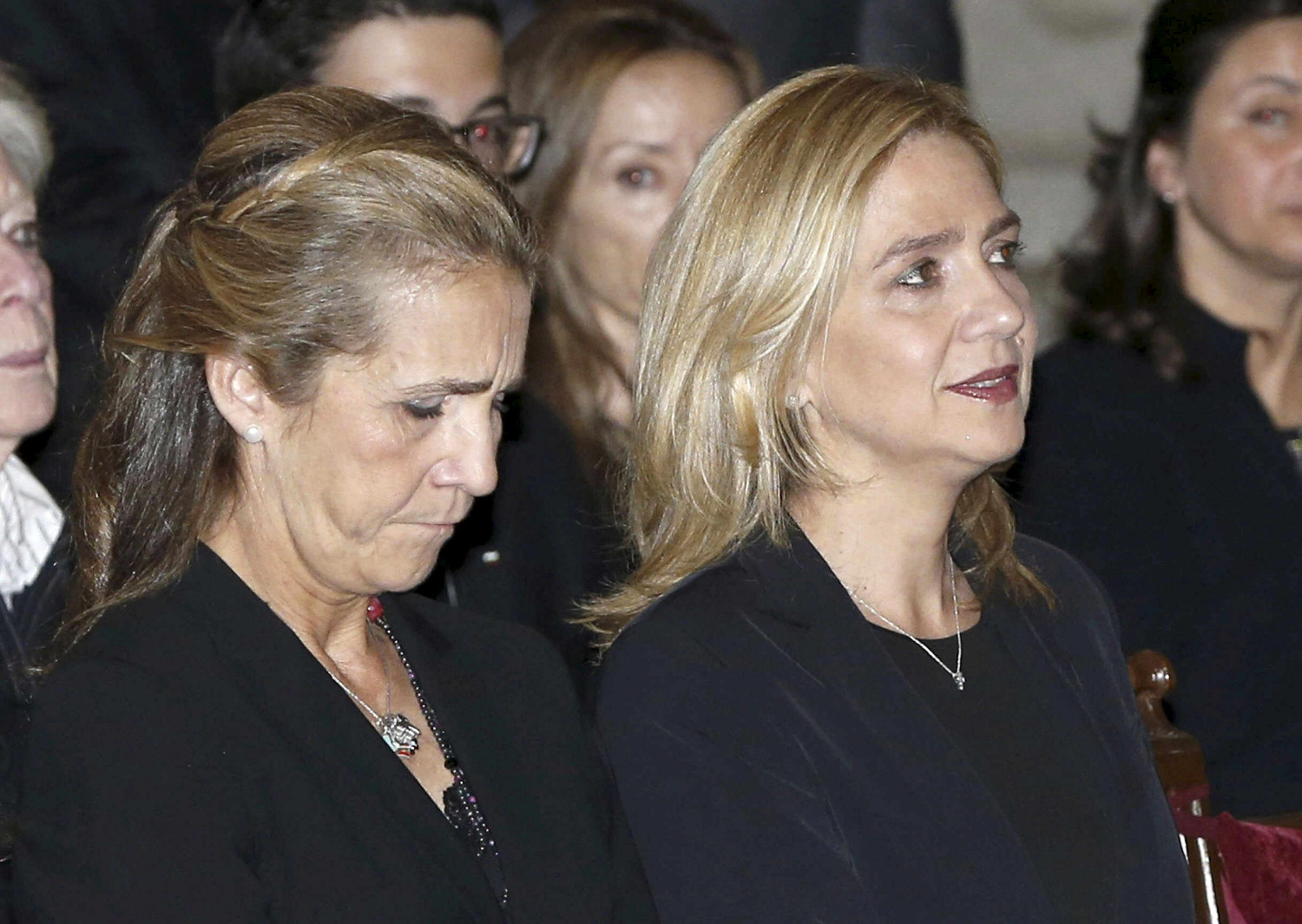 Cristina de Borbon (R) and her sister Elena, the sisters of Spanish King Felipe, attend a funeral service in San Lorenzo de El Escorial, near Madrid, Spain, October 8, 2015 (by REUTERS/Juan Carlos Hidalgo)