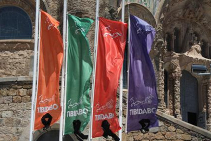 Flags at the entrance of the Tibidabo's amusement park with grief mantles