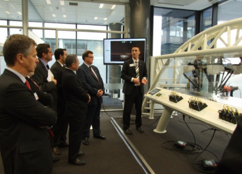 The Catalan minister and the rest of the group at Omron, in Barcelona (by ACN)