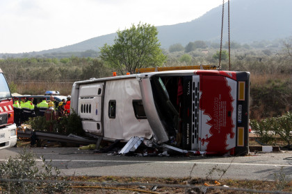 The coach overturned after hitting a car travelling in the opposite direction (by ACN)
