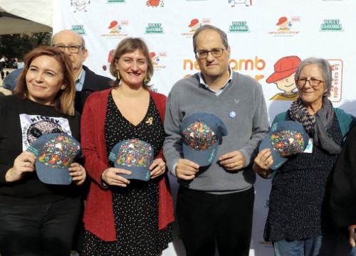 Catalan president Quim Torra, with health minister Alba Vergés to his right, participated in the 2019 edition of 'Posa't la gorra' for pediatric cancer (by Rubén Moreno/Presidència)
