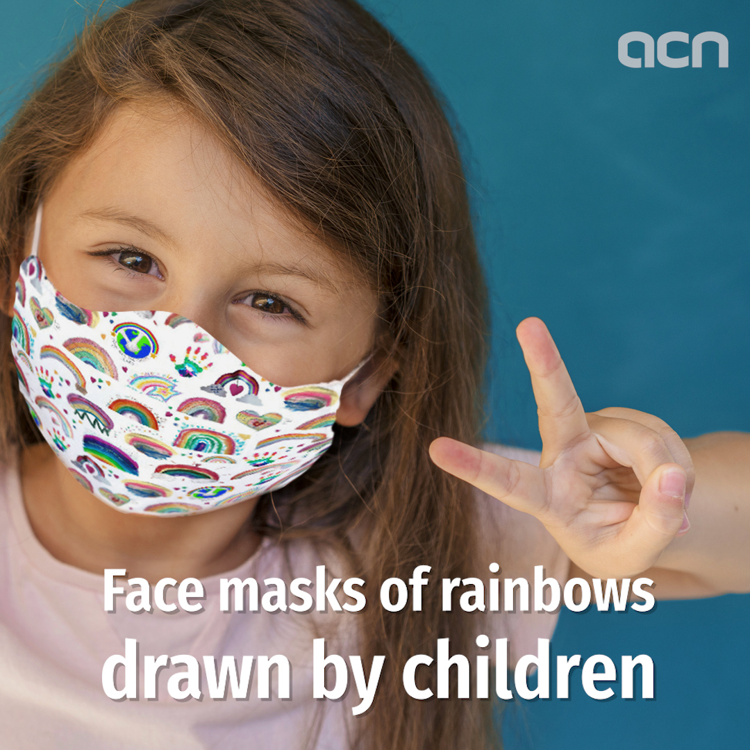 Face masks of rainbows drawn by children