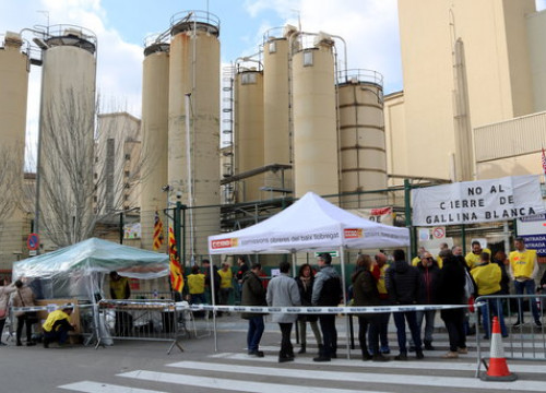 Factory workers protest against its closure in a Barcelona suburb