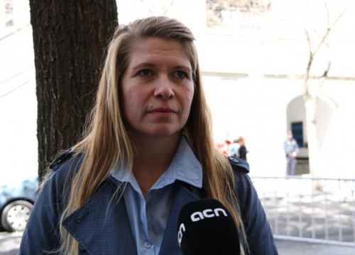 Icelandic observer Katrín Oddsdóttir speaking outside the trial in Madrid