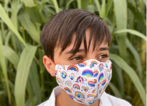 Image of a child wearing the MasksForAll rainbow mask