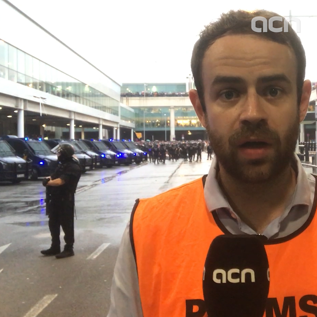 Tension at Barcelona airport as police clash with protesters