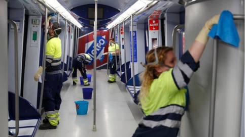 Workers cleaning the Madrid metro on March 16, 2020