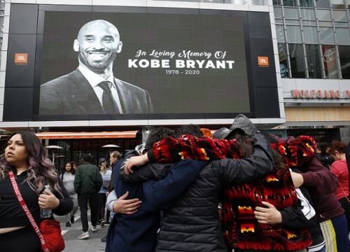 Image of late NBA superstar Kobe Bryant projected outside Staples Center, in Los Angeles (by Monica Almeida/Reuters)