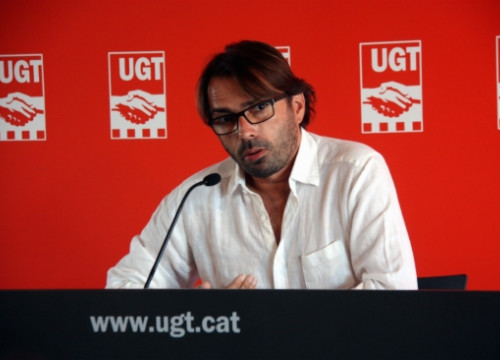 Camil Ros presenting the report at UGT's offices in Barcelona (by A. Villar)