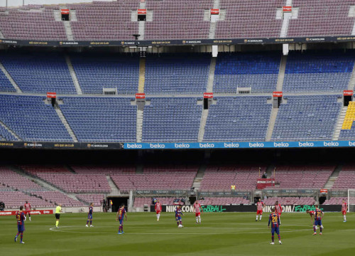 The empty stands of the Camp Nou stadium, as Barça take on Granada in La Liga (image by REUTERS/Albert Gea)