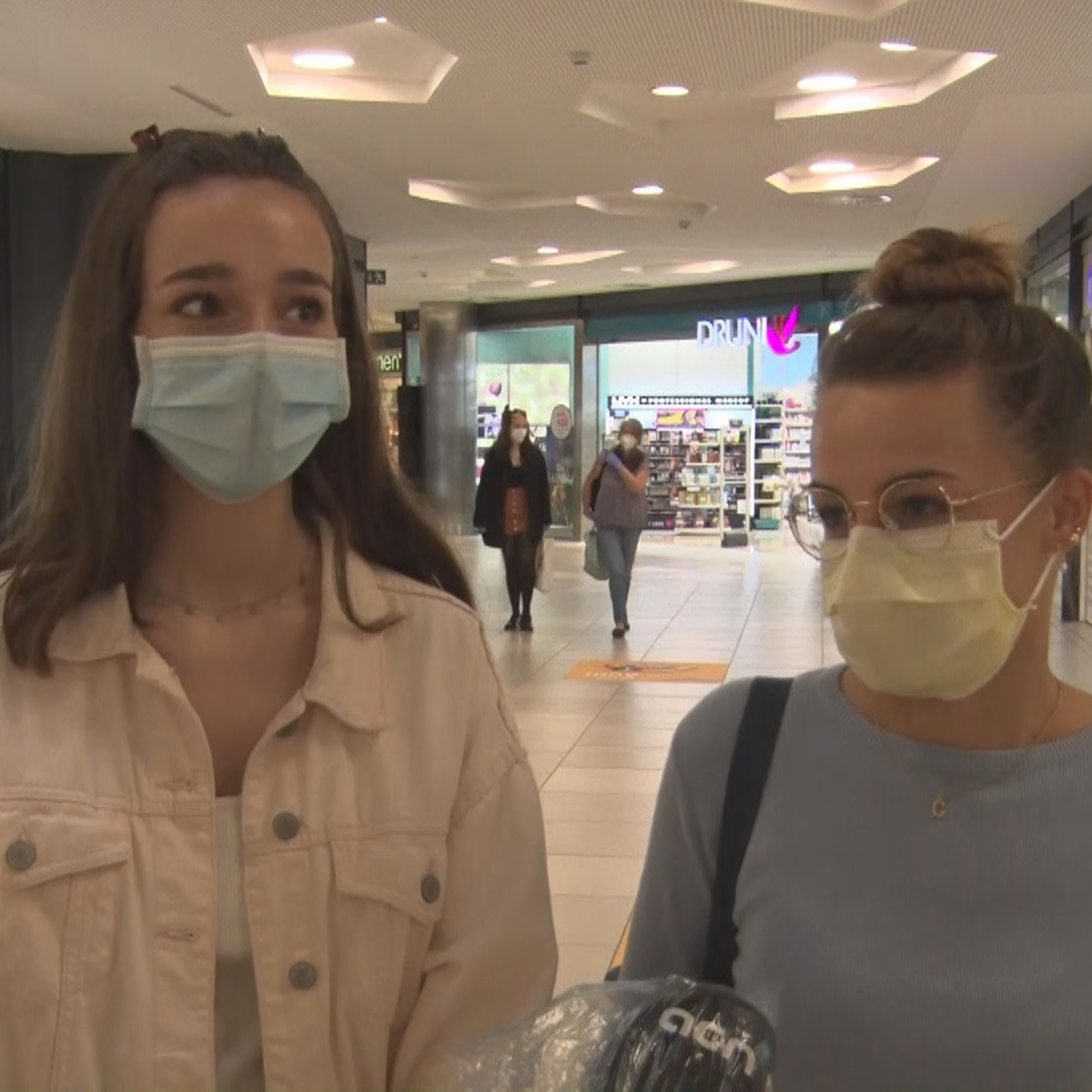 Two excited shoppers say they have to 'be careful there's not another outbreak'