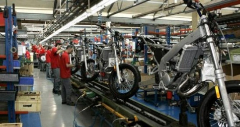 Workers assembling Derbi motorbikes (by Derbi)