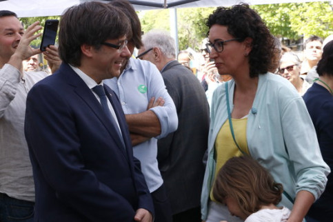 The Catalan president, Carles Puigdemont, with Esquerra's secretary general, Marta Rovira