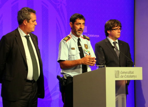 Former Catalan home affairs minister Joaquim Forn, former Catalan police head Josep Lluís Trapero and Catalan former president Carles Puigdemont on August 21, 2017, announcing that Younes Abouyaaqoub had been shot dead (by Pere Francesch)
