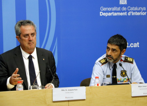 Catalan home affairs minister, Joaquim Forn, and police chief officer, Josep Lluís Trapero