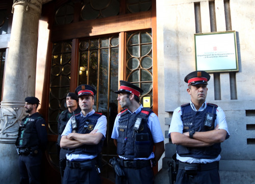 Some Catalan and Spanish police officers guarding Catalonia's department of Economy on Wednesday