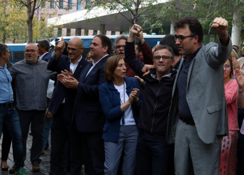 Josep Maria Jové and Lluís Salvadó stand with some colleagues now jailed for their roles in the 2017 independence push (by Pol Solà)