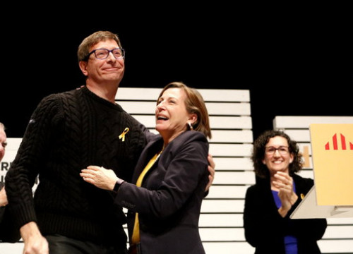 The Catalan minister of the deposed government, Carles Mundó, is hugged by the Catalan Parliament president, Carme Forcadell, in the Esquerra's kick-off event few hours after being freed