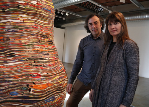 Xavier Escribà and Clarie Cayla stand next to one of Escribà's pieces on display at the Can Mario museum in Palafrugell (by Lourdes Casademont)