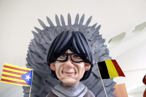 Carles Puigdemont depicted with a Belgian and Estelada (Catalan independence) flags and sitting on the Iron Throne from the Game of Thrones series in the Ninot de les Falles exhibit on February 3 2018 (by José Soler)
