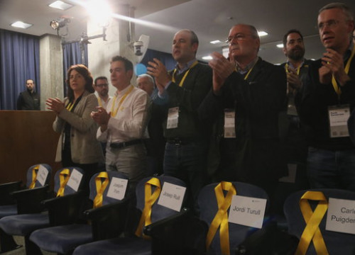 Some yellow ribbons in a PDeCAT party gathering remembering the officials in jail and abroad