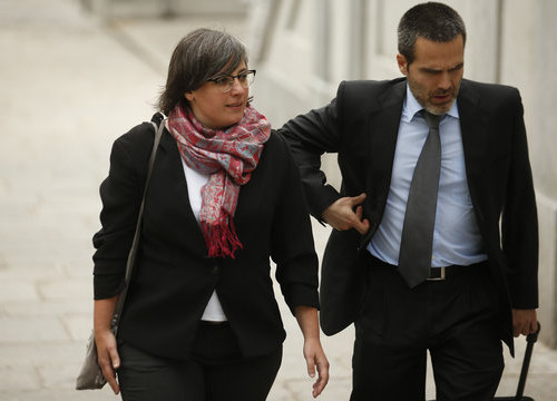 The former CUP MP Mireia Boya and her lawyer entering the Spanish Supreme Court