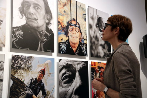 Director of Dalí Museums Montse Aguer looks at the exhibition and portraits of the artist on May 30 2018 (by Gemma Taubert)