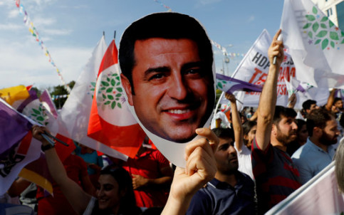 An image of a demonstration of HDP Kurdish party with a mask of Selahattin Demirtas (by Reuters).