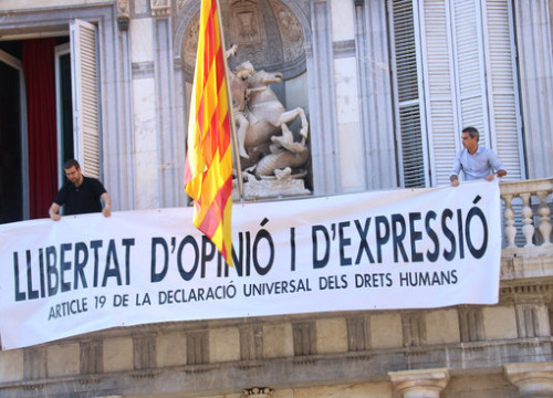 "Banner hanging from the Catalan government headquarters, reading: ""Freedom of opinion and expression. Article 19 of the Universal Declaration of Human Rights"" (by Bernat Vilaró)"