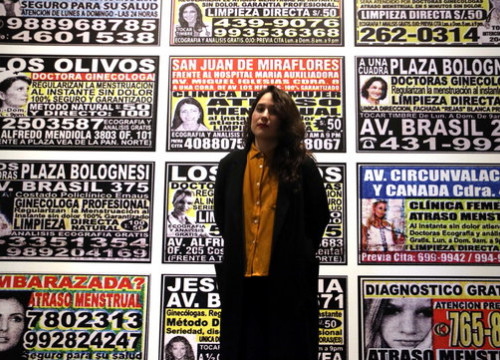 Artist Laia Abril standing in front of one part of her new exhibit in Foto Colectania, 'On Abortion'