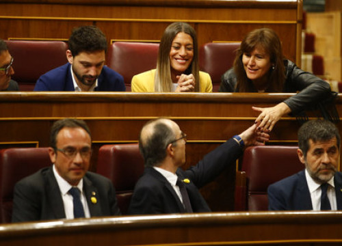 Josep Rull, Jordi Turull, and Jordi Sànchez sitting in the Spanish parliament (by ACN)