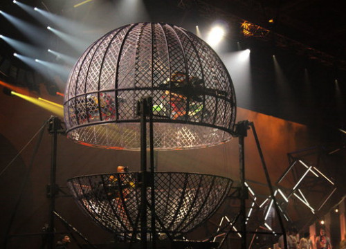 Four motorcyclists riding in a metal cage as one of the spectacles on show in the latest Cirque du Soleil performance in Andorra. (Photo: Albert Lijarcio)