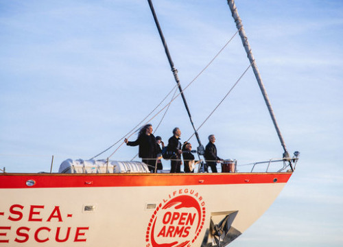 Members of the band Sopa de Cabra standing on the Open Arms Sea Rescue ship (by Gemma Martz)