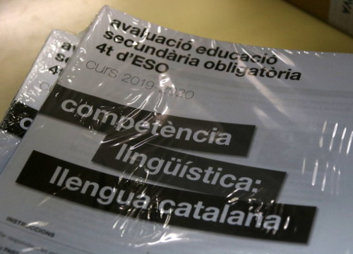 A packet of Catalan language exams wrapped in plastic packaging (by Elisenda Rosanas)