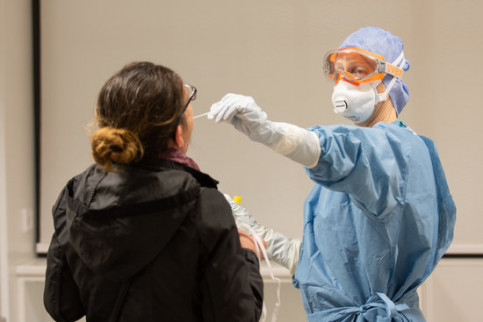A healthcare worker performs a coronavirus test on a person (image by Francisco Avia, Hospital Clínic de Barcelona)