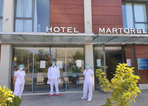 Medical professionals stand outside the Hotel Martorell, converted into a temporary hospital during the Covid-19 pandemic (image loaned by Catalan health department)