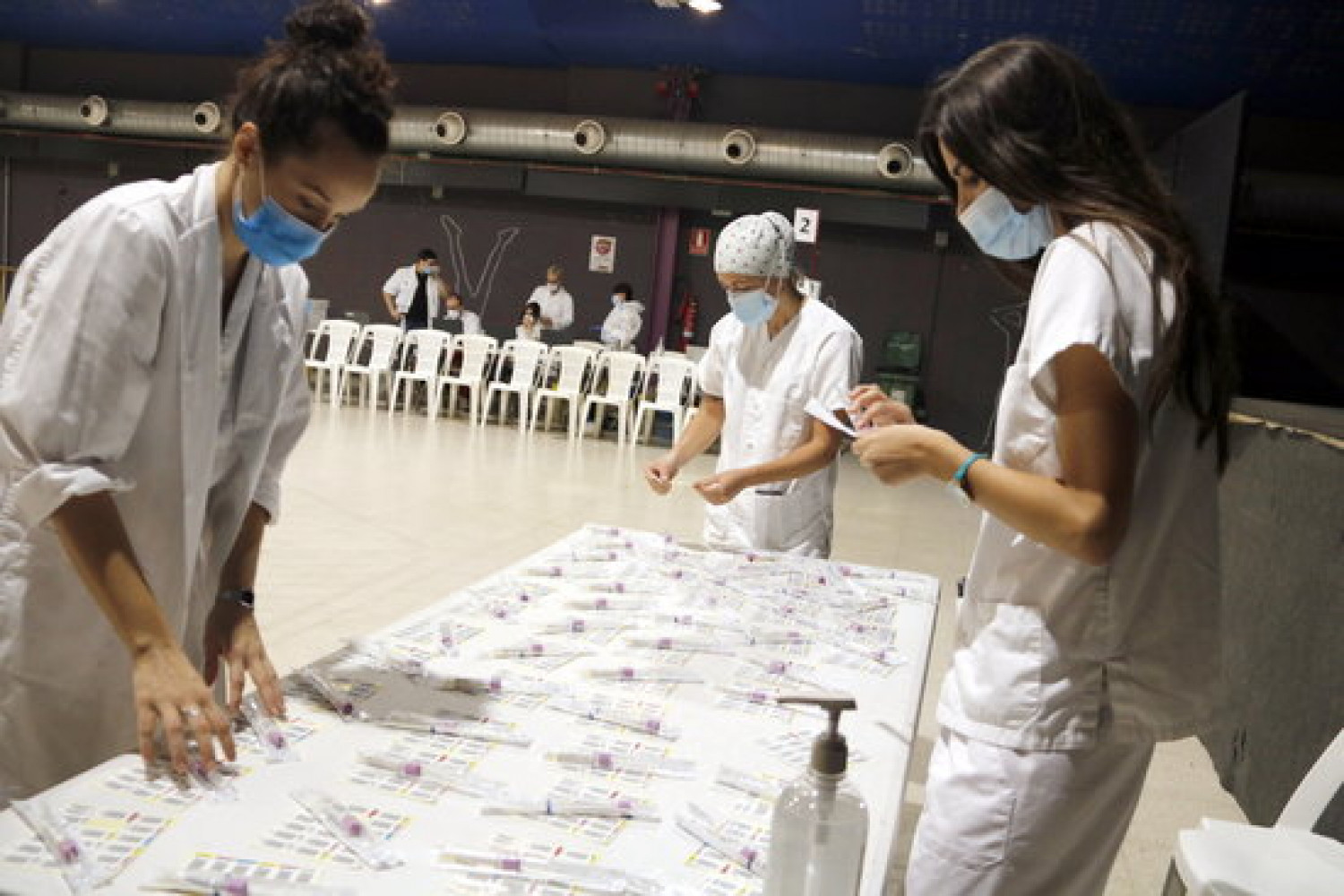 Some health professionals prepare a targeted mass Covid-19 screening in Tàrrega, western Catalonia, on September 7, 2020 (by Oriol Bosch)