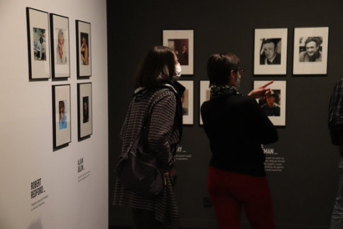 Two visitors look at photographs on display at Girona's Cinema Museum (by Aleix Freixas)