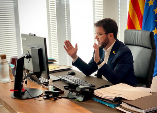 Vice president Pere Aragonès sits at his computer during a conference call in October, 2020 (image from vice president's office)