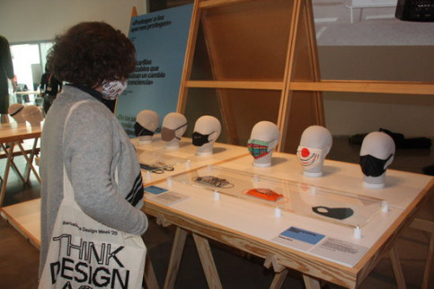 A woman looks at some of the masks on display at the 'Emergency! Designs against Covid-19' exhibition at the Barcelona Design Museum, November 17, 2020 (by Maria Asmarat)