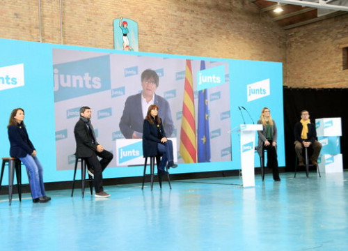 JxCat candidates for February 14 election, with former Catalan president Carles Puigdemont joining via video link, January 24, 2021 (by Laura Fíguls)