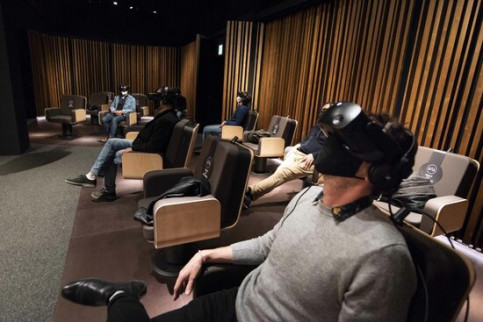 Spectators try on the VR headsets and enjoy the production 'Symphony' in Barcelona's CaixaForum (image from CaixaForum Barcelona)