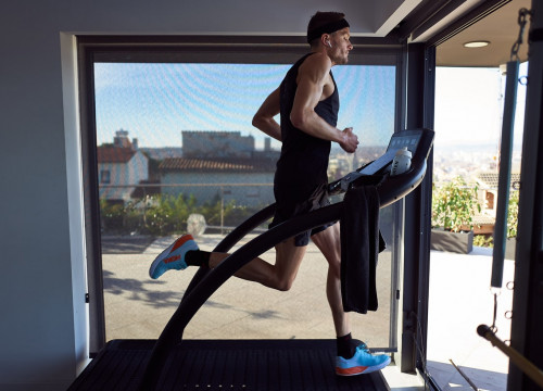 Triathlete Jan Frodeno running on his treadmill during his Ironman challenge in his Girona home, which has raised over €220,000 for health services during the coronavirus crisis (image courtesy of Laureus)