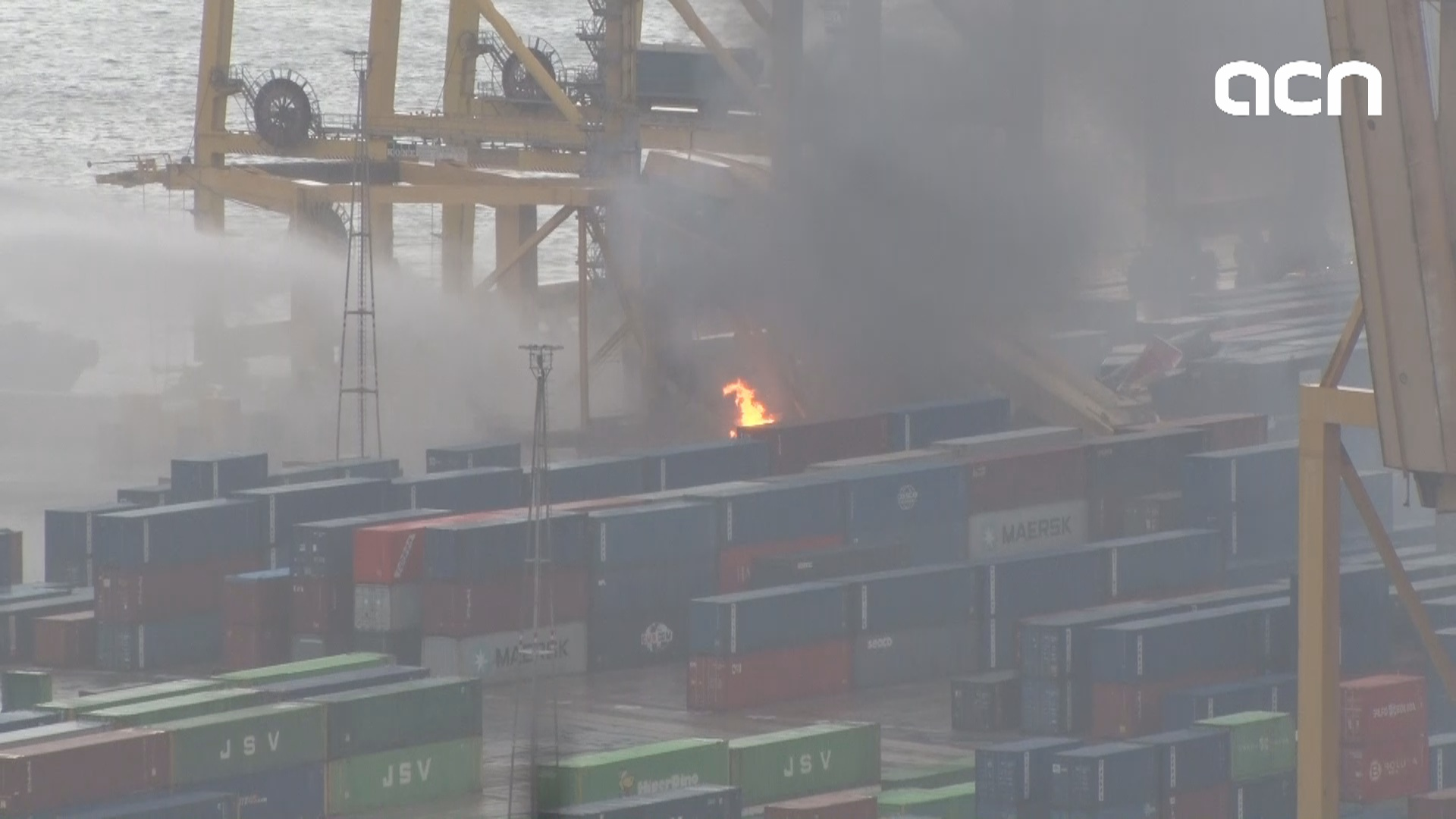 Fire in Barcelona port as ship crashes with crane