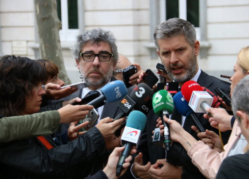 Lawyers representing the Catalan leaders speak outside the Supreme Court in Madrid